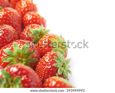 Line of red strawberries isolated - stock photo
