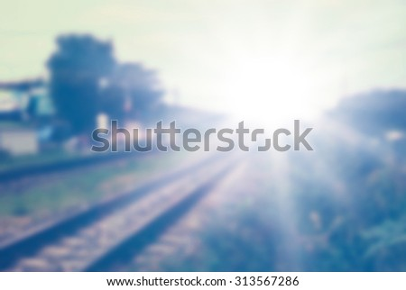 Line of vintage railway crossing crossing blur town of Thailand - stock photo