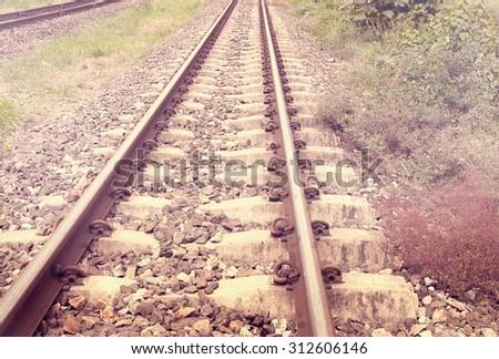 Line of vintage railway crossing in rural of Thailand - stock photo