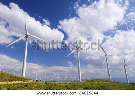 line of wind turbines for electricity production - stock photo