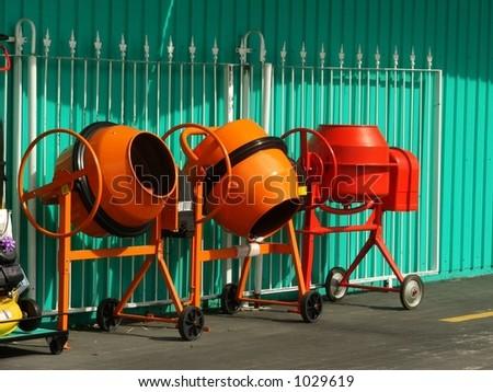 Line-up of concrete-mixers - stock photo