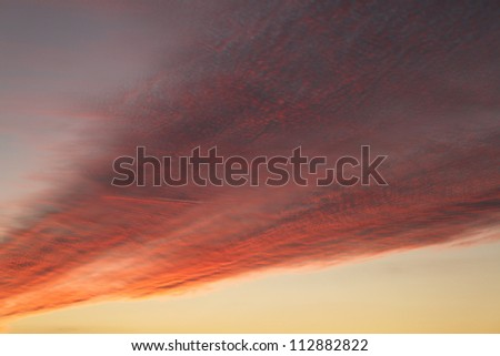 linear clouds at sunset - stock photo