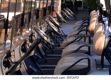 Lined Up Golf Carts - stock photo