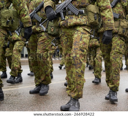 Lined up squad of Estonian soldiers in a military uniform outdoors - stock photo