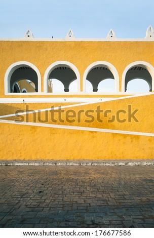 Lines and curves of the yellow monastery, Izamal, Yucatan, Mexico - stock photo