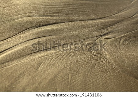 Lines formed by the water on sandy beach in the small town of Mancora in Northern Peru (Selective Focus, Focus where one line branches out into two)  - stock photo