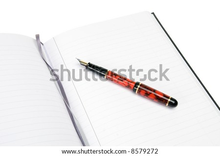 Lines note pad with fountain pen and ribbon place markers - stock photo