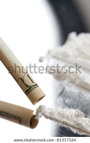 lines of cocaine and ten dollars banknote - stock photo