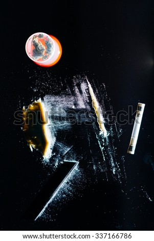 Lines of cocaine on black background - stock photo