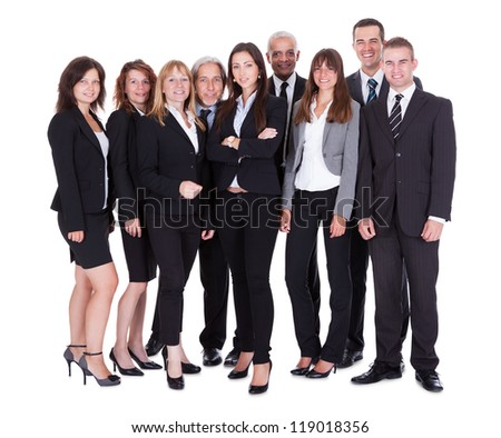Lineup of diverse professional business executives or partners standing relaxed in a row isolated on white - stock photo