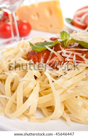 Linguine pasta with fresh tomato sauce, grated cheese and basil - stock photo