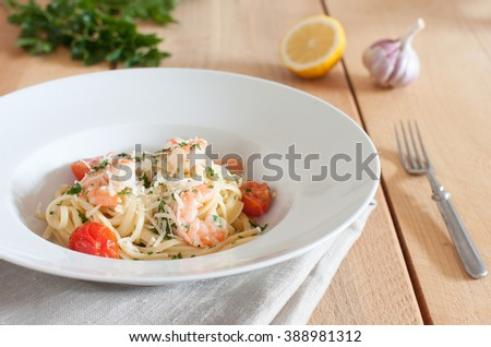 Linguine with shrimps, cherry tomatoes and fresh Parmesan cheese - stock photo