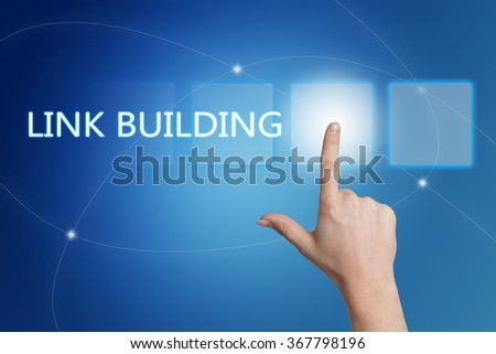Link Building - hand pressing button on interface with blue background. - stock photo
