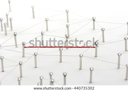 Linking entities. Hotline, VPN, tunneling, dedicated line, Network, networking, social media, connectivity, internet communication abstract. Fat red wire in a web of silver wires on white background.