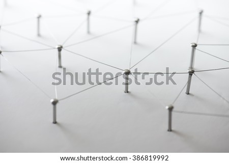 Linking entities. Network, networking, social media, connectivity, internet communication abstract. Web of thin silver wires on white background. - stock photo