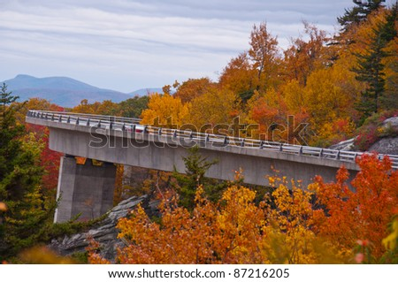 Linn Cove Viaduct, North Carolina. Colorful autumn foliage  surrounds this architectural masterpiece on the Blue Ridge Parkway near Grandfather Mountain. - stock photo
