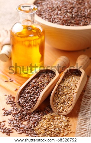 Linseed oil and flax seeds - stock photo