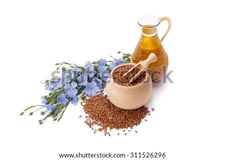 linseed oil, flaxseed and flowers isolated on a white background - stock photo