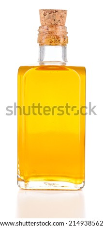 Linseed oil or flaxseed oil in a bottle isolated on white background. Flax oil cold presses, non refined. - stock photo