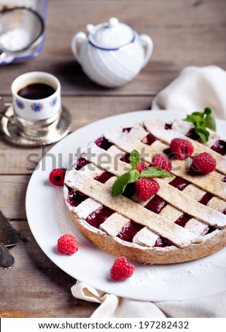 Linzer tart torte with raspberry filling and fresh raspberry - stock photo