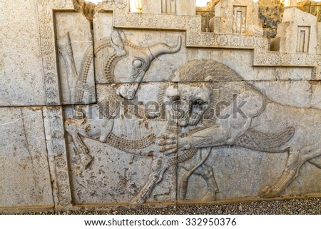 Lion and bull stone bas-relief detail in the old city Persepolis. - stock photo
