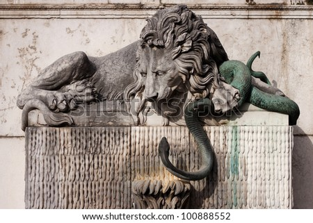 Lion and green snake sculpture  in Grenoble, France.