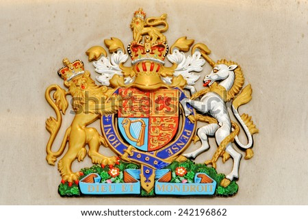 Lion and unicorn on English heraldic coat of arms - stock photo
