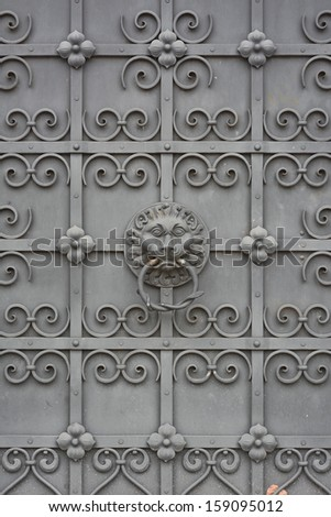 Lion Face on Wrought Iron Door at the Bavarian National Museum in Munich  - stock photo