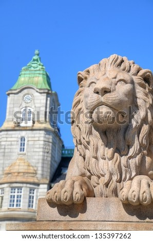 Lion figure by the Parliament of Norway in Oslo, Norway - stock photo