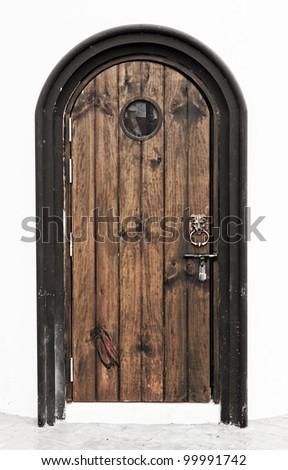 lion headed door knocker on painted wooden door - stock photo