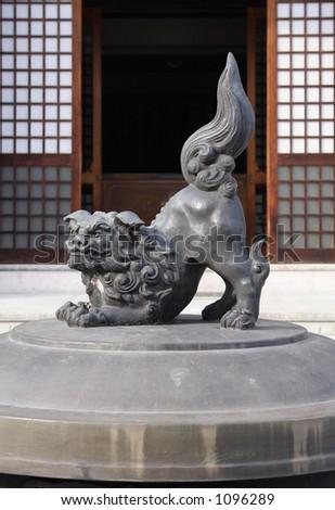 Lion statue atop an incense burner at Zenkoji Temple, Nagano, Japan - stock photo