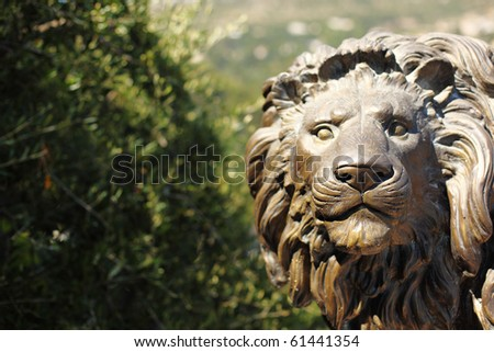 lion statue in park park on background - stock photo