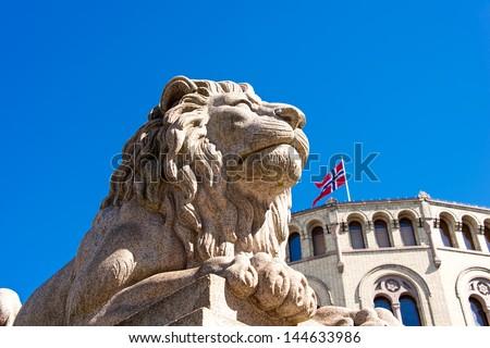 Lion statue near Norwegian parliament Storting Oslo, Norway - stock photo