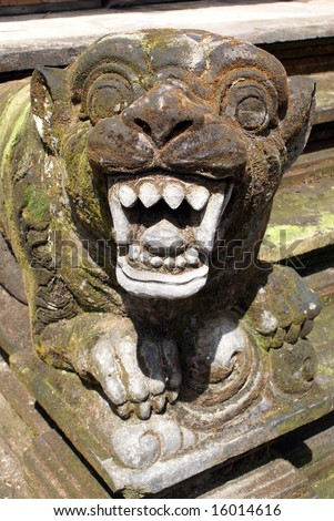 Lion with teeth on the staircase, Tirta Empul, Bali