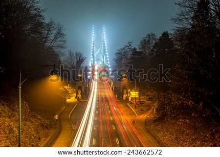 Lions Gate bridge covered in fog in Vancouver, British Columbia, Canada - stock photo
