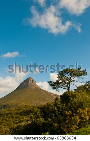 Lions Head to the right of Table Mountain in Cape Town. - stock photo
