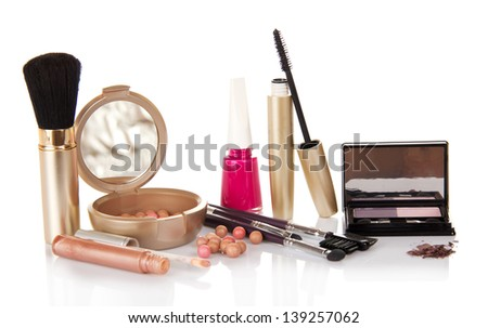 Lip gloss, mascara, eye shadow,the blush  and the nail varnish, isolated on white - stock photo