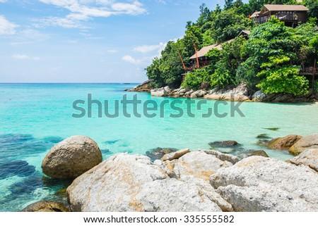 Lipe island clear sea and resort on mountain - stock photo