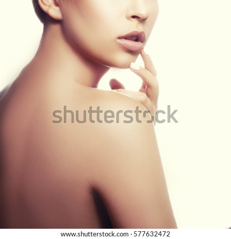 https://thumb9.shutterstock.com/display_pic_with_logo/3288392/577632472/stock-photo-lips-and-shoulders-of-young-caucasian-girl-with-natural-makeup-woman-portrait-toned-577632472.jpg Toned