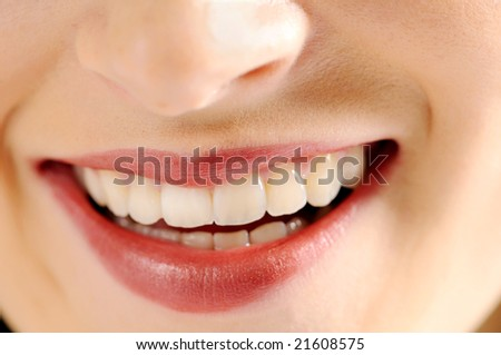 Lips of young attractive smiling woman