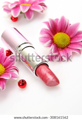 lipstick and flowers - stock photo