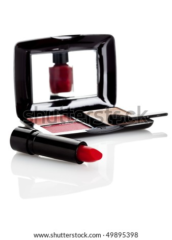 lipstick and make up case with mirror, reflecting nail varnish, on white surface