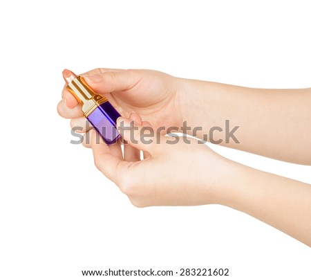 lipstick in handsisolated on white - stock photo