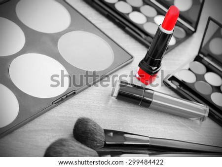 Lipstick makeup brushes make-up eye shadows black and white photo red vintage retro - stock photo