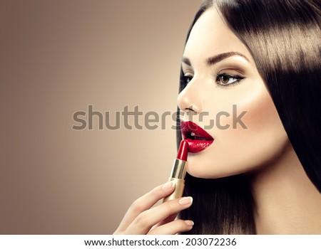 Lipstick. Professional Lips Make-up. Lipgloss. Beauty Girl Applying Lip stick - stock photo