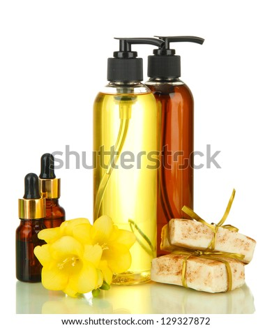 Liquid and hand-made soaps isolated on white - stock photo