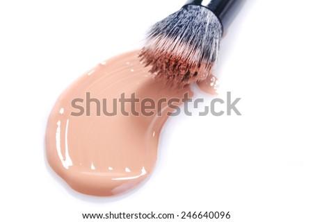 Liquid Beige Make Up Foundation on White Background Smeared - stock photo