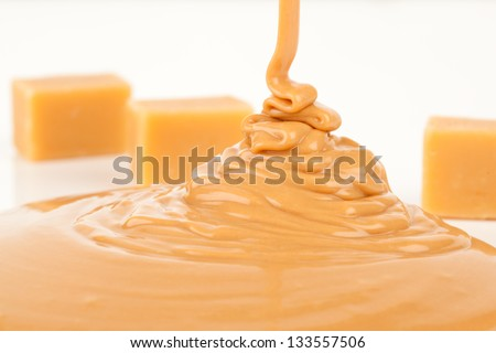 liquid caramel, isolated on white background - stock photo