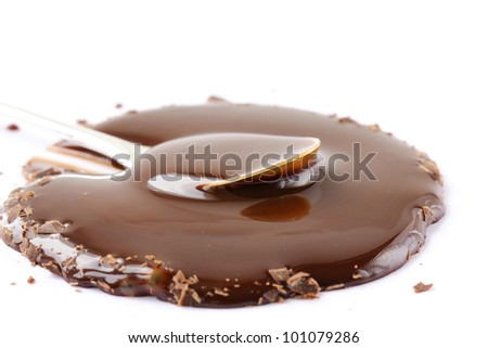 Liquid chocolate with chocolate crumbs on a white background - stock photo