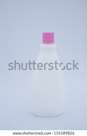 Liquid cosmetic bottle with pink lid - stock photo